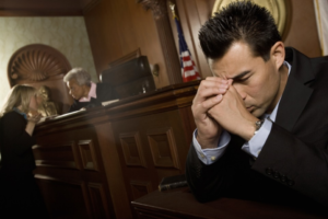 A stressed out man in the court room.